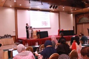Presentation of research findings by IPTA representative.